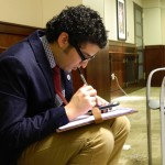 A Washburn student prepares his notes before advocating with Kansas Legislators