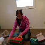 A FHSU The Big Event volunteer helps Mrs. Eigenmann prepare shoe boxes for Operation Christmas Child.