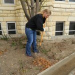 SGA Senator Morgan helps do yard work for the First Methodist Church.