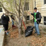 Volunteers help with yard work at the First Methodist Church