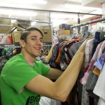 The Big Event volunteer, also TBE scholarship winner, helps sort and tag clothes at The Arc of Central Plains.